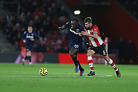 Football - 2019 / 2020 Premier League - Southampton vs. West Ham United<br /> <br /> Michail Antonio of West Ham United outruns Southampton's Jack Stephens to set up another West Ham attack at St Mary's Stadium Southampton<br /> <br /> COLORSPORT/SHAUN BOGGUST