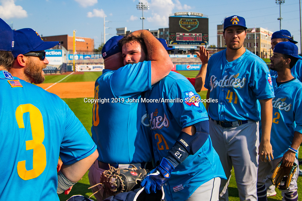 Amarillo Sod Poodles Manager Phillip Wellman and Amarillo Sod Poodles catcher Luis Torrens (21) celebrates after the Sod Poodles won against the Tulsa Drillers during the Texas League Championship on Sunday, Sept. 15, 2019, at OneOK Field in Tulsa, Oklahoma. [Photo by John Moore/Amarillo Sod Poodles]