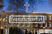 A sign to a Funeral Service shop, Tottenham high road, London.