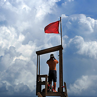 Kure Beach lifeguard Connor Black keeps an eye on beachgoers as the area prepares for Hurricane Irene Wednesday August 24, 2011. Staff Photo by Mike Spencer