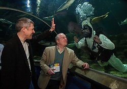 Pictured: Willie Rennie and Peter Barrett met James Struthers (diver) in the shark tank dressed as Shark Bunny<br /> <br /> Scottish Liberal Democrat leader Willie Rennie focused on the environment on the Holyrood campaign trail as he visited Deep Sea World with Mid-Scotland and Fife candidate Peter Barrett<br /> <br /> Ger Harley | EEm 26 March 2016