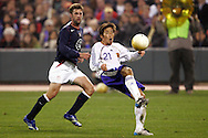10 February 2006: Japan's Akira Kaji (21) plays the ball away from US midfielder Pat Noonan (left). The United States Men's National Team defeated Japan 3-2 at SBC Park in San Francisco, California in an International Friendly soccer match.