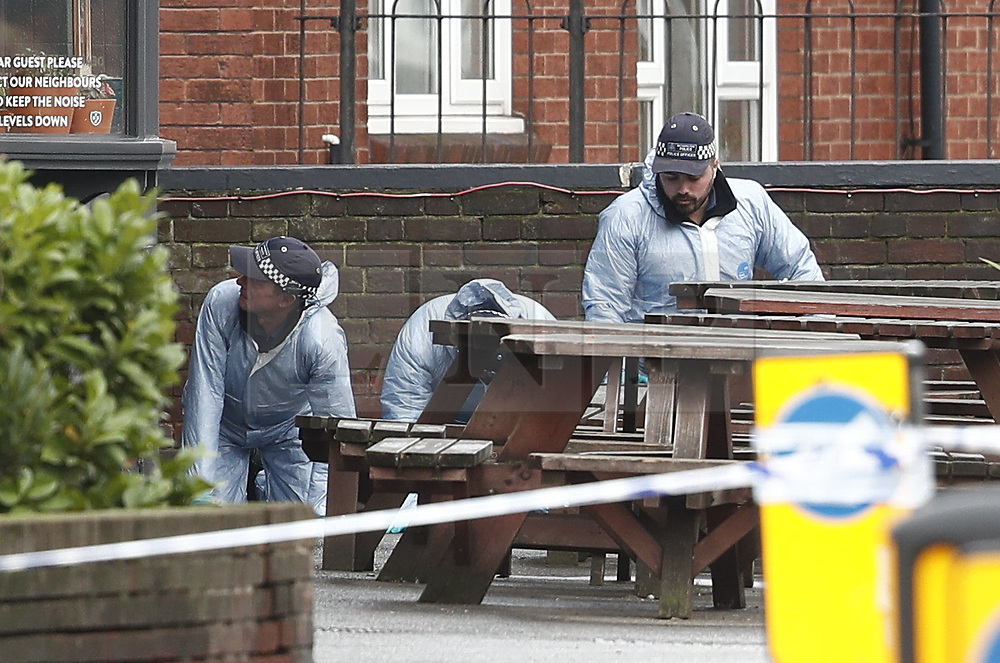 © Licensed to London News Pictures. 03/12/2018. London, UK. Police conduct a search outside The Garden Shed pub near the scene in Wimbledon after a man was shot by police on a pre-planned operation this morning. Photo credit: Peter Macdiarmid/LNP