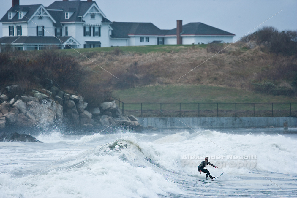 Newport, RI - Surfing at Bailey's beach in the massive swells of Hurricane Sandy
