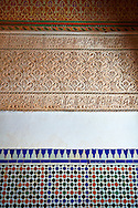 Berber Arabesque Mocarabe plasterwork and Zellige tiles .The Petite Court, Bahia Palace, Marrakesh, Morroco .<br /> <br /> Visit our MOROCCO HISTORIC PLAXES PHOTO COLLECTIONS for more   photos  to download or buy as prints https://funkystock.photoshelter.com/gallery-collection/Morocco-Pictures-Photos-and-Images/C0000ds6t1_cvhPo<br /> .<br /> <br /> Visit our ISLAMIC HISTORICAL PLACES PHOTO COLLECTIONS for more photos to download or buy as wall art prints https://funkystock.photoshelter.com/gallery-collection/Islam-Islamic-Historic-Places-Architecture-Pictures-Images-of/C0000n7SGOHt9XWI