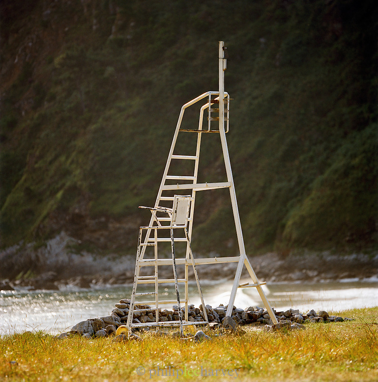 An old lifeguards chair by the waters edge in Valdredo, Asturias, Spain