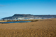 Landscape view of Chesil Beach with Portland island in the background on a beautiful day on Jurassic coast of Dorset, UK.