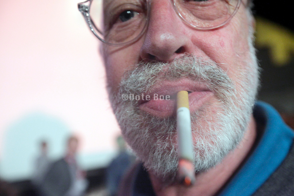 close up of male person exhaling cigarette smoke