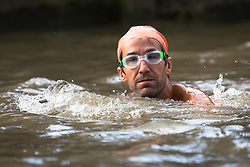 © Licensed to London News Pictures. 31/08/2018. London, UK.  A participant takes part in the Tidal River Swim in Hammersmith this evening, launching this years Thames Festival. Over 100 brave enthusiasts took part in a 30 minute swim, as they followed the tide towards Chiswich Eycot and back. Photo credit: Vickie Flores/LNP