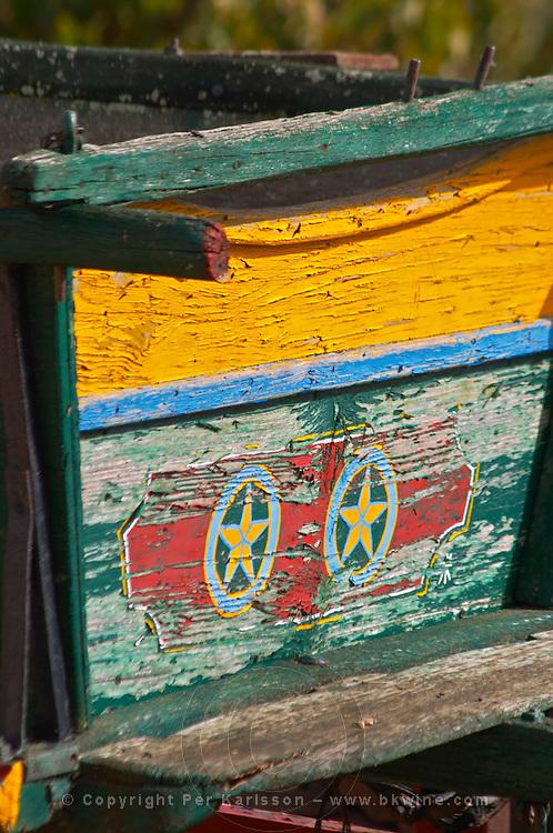 An old colourful and painted farm cart. Herdade da Malhadinha Nova, Alentejo, Portugal
