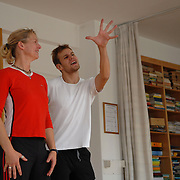 "World Champion same-sex ballroom dancer Robert Tristan Szelei, center, gives a ballroom lesson to female dance couple Denae Wagner, left, and Cindy Mills, both of California, at an apartment belonging to the parents of Szelei's dance partner, Gergely Darabos, in Budapest, Hungary on October 20, 2006. Wagner and Mills were preparing to compete in the 1st Csardas Cup 2006, the first same-sex international championship ever held in Eastern Europe, held on the same day as the 2nd Annual World Championship Same Sex Dancing Competition in Budapest on October 21, 2006. ..Szelei and Darabos, who are known as the ""Black Swans,"" are the reigning world champions in men?s Latin same-sex ballroom dancing. They competed in the 2nd annual World Championship and the Csardas Cup, the first-ever Eastern European same-sex ballroom competition, the pinnacle event of the blossoming same-sex ballroom scene...Szelei and Darabos went on to win the men?s Standard division and finished fourth in the Latin division. ..The event was organized by the US-based World Federation of Same-Sex Dancing, which hosted the first World Championship Same-Sex championships in 2005 in Sacramento, California. The Black Swans did a large amount of the coordination and planning in Budapest, a city that had never seen an event of this kind. When government funding fell through, they secured funding from patron Desire (accent on the ?e?) Dubounet, owner of the local Club Bohemian Alibi drag club. ..The World Championship events are newly recognized, but same-sex dancers have been competing on a national and international circuit for a number of years, especially in Europe, including at the Eurogames, the Gay Games, the London Pink Jukebox Trophy and the Berlin Open, among others. Countries including the United States, the Netherlands, Germany and, now, Hungary, hold their own national same-sex championships. Hungary held its first national championships in April 2006...Szelei and Darabos spent three months at the"