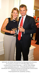 MICHAEL & ANNIE WAINWRIGHT of Boodle & Dunthorne, at a party in London on 7th May 2003.PJJ 5