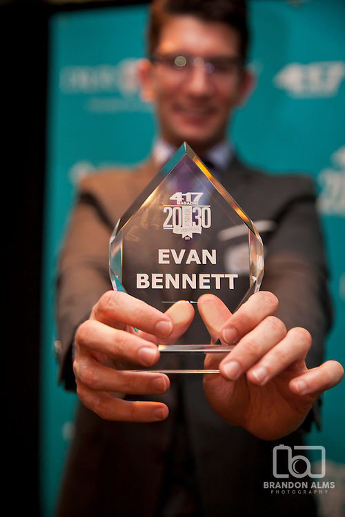 Evan Bennett proudly displays his award at the 20 under 30 party hosted by 417 Magazine.
