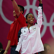 Gabrielle Douglas, USA,  with coach Liang Chow during her Gold medal performance in the Women's Individual All Round competition during the artistic gymnastic competition at North Greenwich Arena during the London 2012 Olympic games London, UK. 2nd August 2012. Photo Tim Clayton