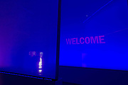 BAE Systems presentation hospitality chalet entrance, exhibited at the Farnborough Air Show, England. The word 'Welcome' is shown against a back-projected blue hue. BAE Systems plc is a British multinational defence, security and aerospace company headquartered in London in the United Kingdom and with operations worldwide.