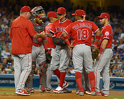 June 27, 2017 - Los Angeles, California, U.S. - Los Angeles Angels manager Mike Scioscia, left, pulls starting pitcher Jesse Chavez, center, from the game in the sixth inning of a Major League baseball game against the Los Angeles Dodgers at Dodger Stadium on Tuesday, June 27, 2017 in Los Angeles. (Photo by Keith Birmingham, Pasadena Star-News/SCNG) (Credit Image: © San Gabriel Valley Tribune via ZUMA Wire)