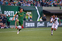 June 15, 2018 - Portland, Oregon, U.S. - PORTLAND, OR - JUNE 15: Portland Timbers defender Zarek Valentin controls a ball in mid air chased by LA Galaxy defender Ashley Cole during the Portland Timbers game versus the LA Galaxy in a United States Open Cup match on June 15, 2018, at Providence Park, OR. (Photo by Diego G Diaz/Icon Sportswire) (Credit Image: © Diego Diaz/Icon SMI via ZUMA Press)