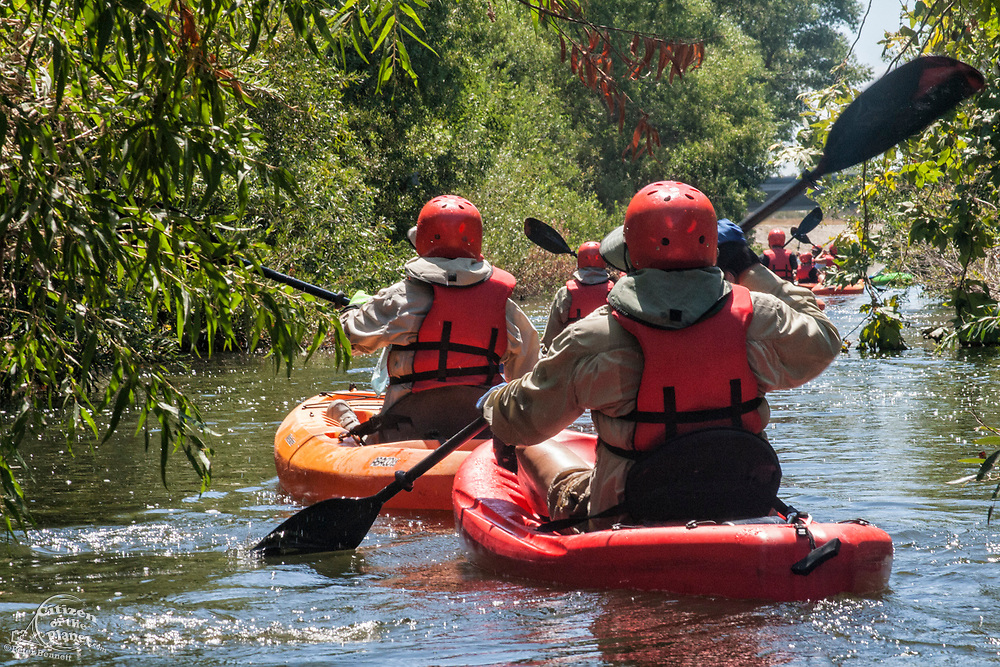 A kayak tour is led  by LA River Expeditions in one of the portions of the Los Angeles River opened as a Recreational Zone during the Summer months. Sepulveda Basin Recreation Area, Los Angeles, California, USA