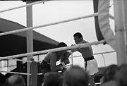 Ali vs Lewis Fight, Croke Park,Dublin.<br /> 1972.<br /> 19.07.1972.<br /> 07.19.1972.<br /> 19th July 1972.<br /> As part of his built up for a World Championship attempt against the current champion, 'Smokin' Joe Frazier,Muhammad Ali fought Al 'Blue' Lewis at Croke Park,Dublin,Ireland. Muhammad Ali won the fight with a TKO when the fight was stopped in the eleventh round.<br /> .<br /> Picture shows Ali gaining the upperhand in the non title bout.