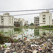 CAPTION: Vacant plots in Chikitsak Nagar, bought in anticipation of appreciation, lie waterlogged and are being used for waste disposal by the slum residents, thus increasing the risk and incidence of disease. LOCATION: Chikitsak Nagar, Indore, Madhya Pradesh, India. INDIVIDUAL(S) PHOTOGRAPHED: N/A.