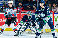 KELOWNA, BC - MARCH 6: Dillon Hamaliuk #22 of the Kelowna Rockets looks for the pass as Ryan Gottfried #27 and Roddy Ross #1 of the Seattle Thunderbirds defend the net during second period at Prospera Place on March 6, 2020 in Kelowna, Canada. (Photo by Marissa Baecker/Shoot the Breeze)