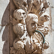 """A sculpture (maskeron) on Onofrio's Fountain in the old city of Dubrovnik, Croatia.<br /> <br /> Dubrovnik serves as the official setting of """"King's Landing"""" from the popular TV show """"Game of Thrones""""."""