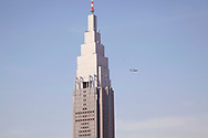 """May 26, 2019, Tokyo, Japan: President Donald Trump on his second day of being in Japan flies past the Shinjuku skyline on Marine One enroute to a game of golf with PM Shinzo Abe in Mobara, Chiba. The building that looks like the Empire State Bldg. is called the """"NTT Docomo Yoyogi Building"""". Trump is on a four day state visit to Japan and later in the day will also attend a sumo tournament. Photo by Torin Boyd."""