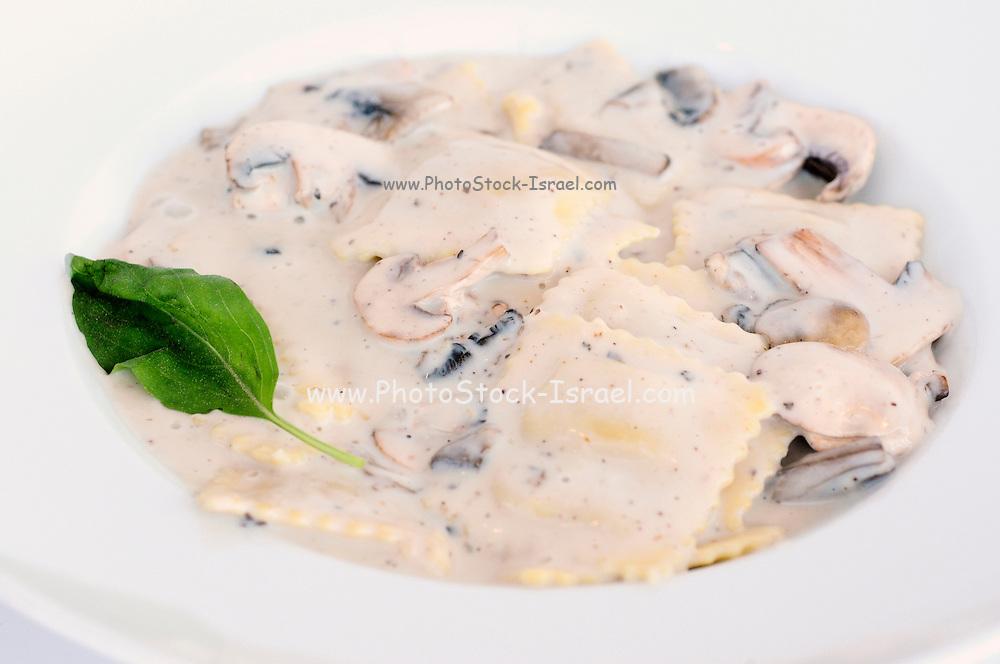 Ravioli and mushroom sauce