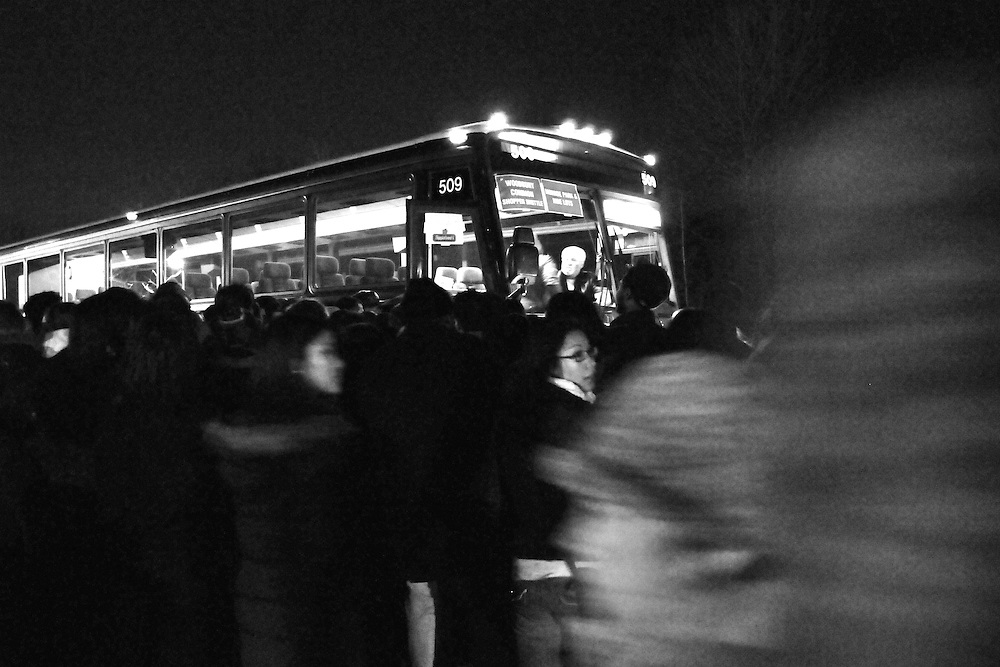Shoppers crowd around a bus headed for the outlet mall Black Friday Nov. 28 2008.  The crowd refused to form an orderly line for the bus despite instructions from police.