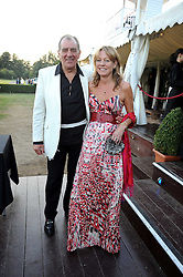 GEOFFREY GODBOLD and EMMA HARTLEY at the annual Ham Polo Club Summer Ball held at the club, Petersham Road, Richmond, Surrey on 25th July 2008.<br /> <br /> NON EXCLUSIVE - WORLD RIGHTS