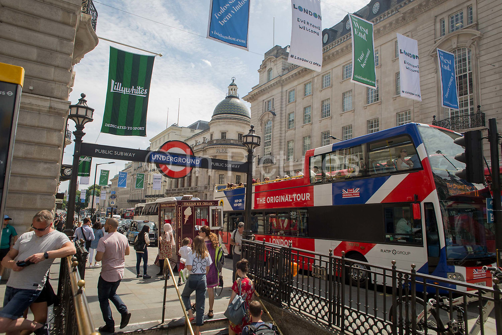 A tour bus with The Original Tour latest branding of a Union jack flag drives through Piccadilly Circus Square, on 7th July 2017, in central London.