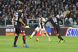 November 3, 2018 - Turin, Piedmont, Italy - Douglas Costa (Juventus FC) and Nicolo Barella (Cagliari Calcio) competes for the ball during the Serie A football match between Juventus FC and Cagliari Calcio at Allianz Stadium on November 03, 2018 in Turin, Italy. Juventus won 3-1 over Cagliari. (Credit Image: © Massimiliano Ferraro/NurPhoto via ZUMA Press)