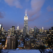 A snowy scene of the Empire State Building is seen in New York CIty on Thursday, Jan. 23, 2014. A recent snow storm created by a polar vortex, dumped almost a foot of snow in some areas of New York City, followed by bitter cold. The NFL plans on featuring the Super Bowl at MetLife stadium in New Jersey on February 3rd amid growing concerns about more snow and bitter cold arriving just prior to the game.  (AP Photo/Alex Menendez)