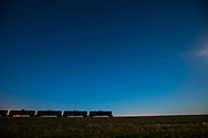 Stars are seen in the early evening as oil tank cars waiting to be filled with crude oil from trucks coming in from the Bakken oil field sit waiting at a transfer station in the small town of Epping, ND on Sunday Sept 15, 2013. Back in 2008 the North Dakota oil boom started its ongoing period of extraction of oil from the Bakken formation. The amount of jobs the oil boom has provided North Dakota has helped give it the lowest unemployment rate in the United States and and gave it a billion dollar surplus. Shale gas reserves has given the United States more independence over other nations such as Venezuela and countries in the Middle East.  Photo Ken Cedeno