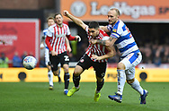 Brentford forward Neal Maupay (9) and Queens Park Rangers Toni Leistner*** during the EFL Sky Bet Championship match between Brentford and Queens Park Rangers at Griffin Park, London, England on 2 March 2019.