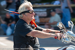 Rainbow The Macaw rides on the shoulder of Myles Bratter every year. Here they are caught riding down Lakeside Avenue in the Weir's Beach area during Laconia Motorcycle Week, New Hampshire, USA. Wednesday June 14, 2017. Photography ©2017 Michael Lichter.