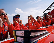 Pilots the 'Red Arrows', Britain's Royal Air Force aerobatic team block ears during pre-flight briefing before display..
