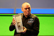 Stuart Bingham of England cheekily pokes his tongue out as he lifts the new Ray Reardon trophy after winning the match.  Coral Welsh Open Snooker 2017, final match, Judd Trump of England v Stuart Bingham of England at the Motorpoint Arena in Cardiff, South Wales on Sunday 19th February 2017.<br /> pic by Andrew Orchard, Andrew Orchard sports photography.