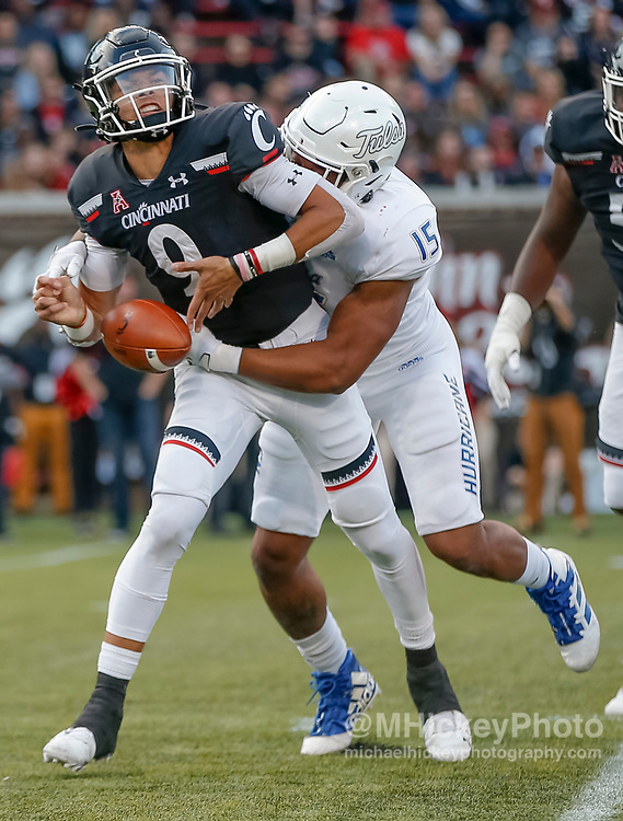 CINCINNATI, OH - OCTOBER 19: Desmond Ridder #9 of the Cincinnati Bearcats fumbles the ball as Trevis Gipson #15 of the Tulsa Golden Hurricane makes the hit during the second half at Nippert Stadium on October 19, 2019 in Cincinnati, Ohio. (Photo by Michael Hickey/Getty Images) *** Local Caption *** Desmond Ridder; Trevis Gipson