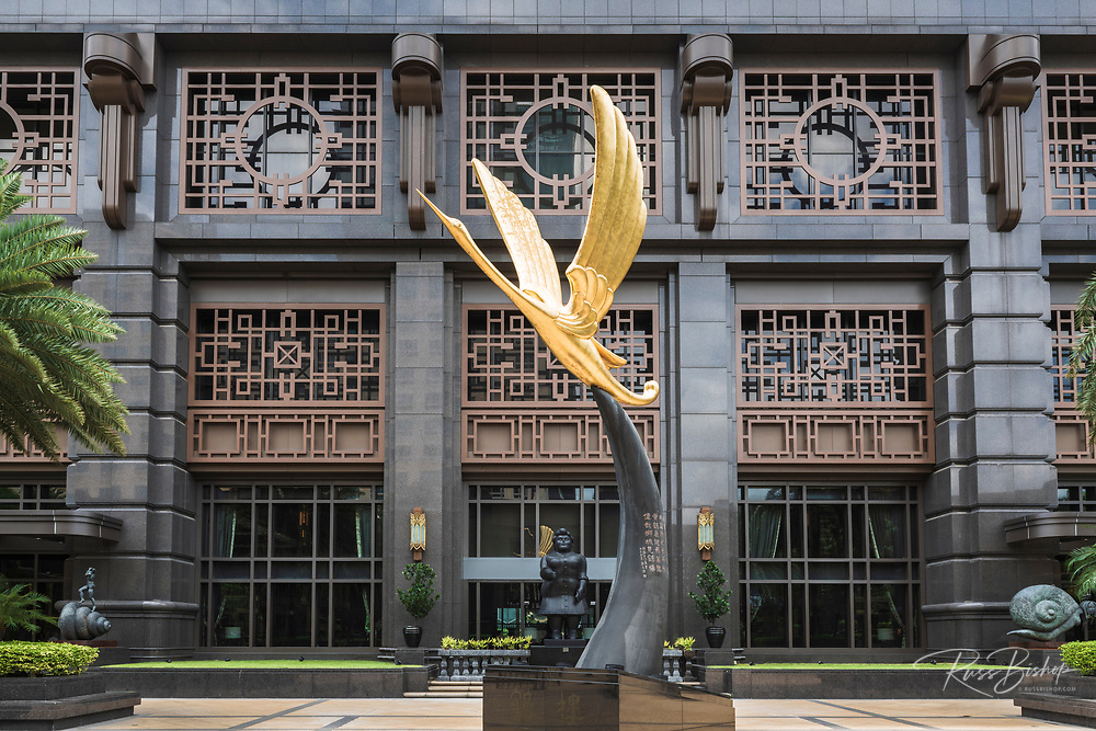 Golden crane statue at the entrance to Parkview Square, Singapore, Republic of Singapore