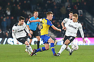 Derby County forward David Nugent (28) and Derby County forward Martyn Waghorn put pressure on Southampton midfielder James Ward-Prowse (16) during the The FA Cup 3rd round match between Derby County and Southampton at the Pride Park, Derby, England on 5 January 2019.
