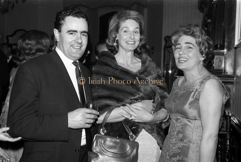 08/05/1964<br /> 05/08/1964<br /> 08 May 1964<br /> Reception and buffet dinner-dance for 5th Annual Tara Cup Rotterdam - Dublin Air Rally given by J.H. Van Anrooy at the Glencormac House Hotel, Co. Wicklow. At the event were (l-r): Mr. David I. Dand, Joint Managing Director of Gilbeys of Ireland; Mrs Richar Seigne, Ballsbridge, Dublin and Mrs J.H. Van Anrooy of Kilmacanogue.