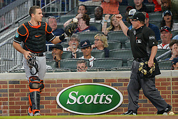 May 18, 2018 - Atlanta, GA, U.S. - ATLANTA, GA Ð MAY 18:  Marlins catcher JT Realmuto (11) shows home plate umpire Jerry Meals (right) the ball after catching a foul ball during the game between Atlanta and Miami on May 18th, 2018 at SunTrust Park in Atlanta, GA.  The call was later overturned via instant replay.  The Miami Marlins defeated the Atlanta Braves by a score of 2 Ð 0.  (Photo by Rich von Biberstein/Icon Sportswire) (Credit Image: © Rich Von Biberstein/Icon SMI via ZUMA Press)