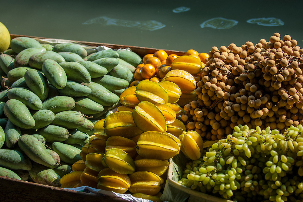 Fruit for sale in the Floating Market at Damnoensaduak in Thailand. The fruit is sold from canoes or row boats in the canals west of Bangkok.