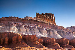 Colorful Castle Peak.  Sculptured by the wind, rain and snow, and painted by the sediments of time, Castle Mountain is a testament of the wonder of the Colorado Plateau. It can be found in Capital Reef National Park.
