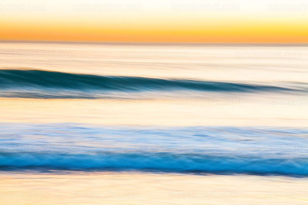 Motion blur picture of a breaking wave at sunset. Photo by Robert Zaleski/rzcreative.com