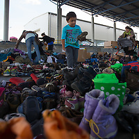 Illegal migrants traveling to Germany choose shoes at an aid distribution point at Hegyeshalom border crossing (about 180 km West of capital city Budapest), Hungary on September 06, 2015. ATTILA VOLGYI