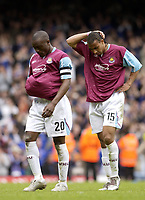 Photo: Daniel Hambury, Digitalsport<br /> West Ham United v Ipswich Town. <br /> The Coca Cola Championship. Play Off Semi Final First Leg.<br /> 14/05/2005<br /> West Ham's captain Nigel Reo-Coker L and Anton Ferdinand leave the  pitch gutted after letting a two goal lead slip away.