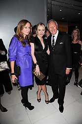 Left to right, LUCY YEOMANS, KATE WINSLET and HAROLD TILLMAN at a party to celebrate Lancome's 10th anniversary of sponsorship of the BAFTA's in association with Harper's Bazaar magazine held at St.Martin's Lane Hotel, London on 19th February 2010.