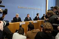 05 JAN 2005, BERLIN/GERMANY:<br /> Joschka Fischer (L), B90/Gruene, Bundesaussenminister, und Gerhard Schroeder (M), SPD, Bundeskanzler, vor Beginn einer Pressekonferenz zur Fluthilfe der Bundesregierung<br /> and Joschka Fischer (L), Federal Minister of Foreign Affairs, und Gerhard Schroeder (M), Federal Chancellor of Germany, before the beginning of a press conferece about the donations for the tsunami-hit nations<br /> IMAGE: 20050105-01-009<br /> KEYWORDS: Gerhard Schröder, Flutkatastrophe, Sturmflut, Erdbeben, Treppe, Tsunami, Journalisten, Fotografen, Kamera, Camera